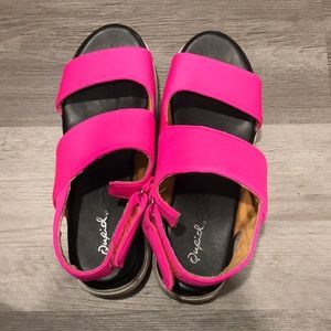 Pink Velcro Cupid sandals with heel.